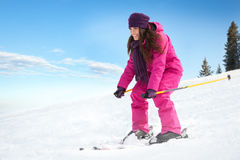 Young woman skiing Stock Image