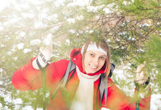 Young woman skiing in forest on winter sunny day. Stock Images