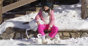 Young woman on skiing holiday Stock Photo