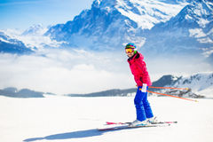 Young woman skiing in the mountains. royalty free stock photography