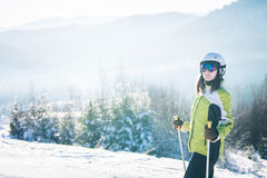 Young woman is skiing in mountains Royalty Free Stock Photos