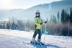 Young woman is skiing in mountains Royalty Free Stock Image