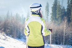 Young woman is skiing in mountains Stock Photo