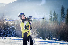 Young woman is skiing in mountains Royalty Free Stock Images
