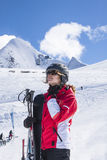 Young woman skiing. Sportswoman taking a deep breath after skiing Stock Photos