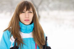 Young woman skiing at winter outdoor. Royalty Free Stock Images