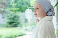 Young woman with skin cancer. Standing on a drip in hospital royalty free stock photos