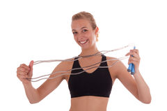 A young woman with a skipping rope Stock Photography