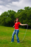 Young woman with skipping rope Royalty Free Stock Images