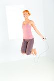 Young woman skipping rope Stock Photo
