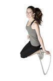 Young woman skips rope Royalty Free Stock Image