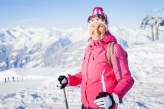 Young woman with skis and a ski wear Royalty Free Stock Images