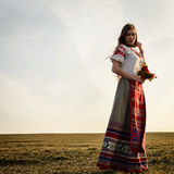 Young woman in Slavic Belarusian national original suit outdoors Stock Photography