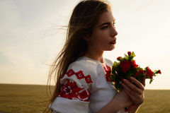 Young woman in Slavic Belarusian national original suit outdoors Royalty Free Stock Image