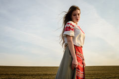 Young woman in Slavic Belarusian national original suit outdoors Royalty Free Stock Photography