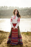 Young woman in Slavic Belarusian national original suit outdoors Stock Photos