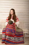 Young woman in Slavic Belarusian national original suit studio Stock Images
