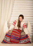 Young woman in Slavic Belarusian national original suit studio Royalty Free Stock Images