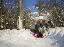 Young woman sledding Royalty Free Stock Photos
