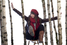 Young woman on a sledge Stock Images