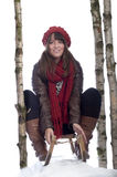 Young woman on a sledge Royalty Free Stock Photos