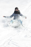 Young woman sledging in deep snow, concept winter and sleigh rid Stock Images