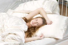 Young woman sleep in bed Stock Image