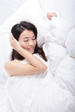 Young woman sleep on bed Stock Images