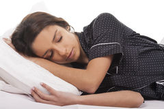 Young woman sleep. Young woman in bed sleeping Stock Photos