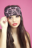 Young woman with sleep mask. Looking at camera royalty free stock photo