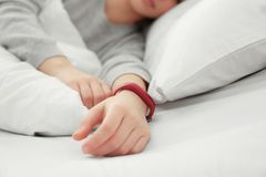 Young woman with sleep tracker resting. In bed at home stock photo