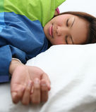 Young woman sleeping. Peacefully in her bed in her bedroom Stock Images