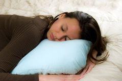 Young Woman Sleeping. On a Blue Pillow Stock Image