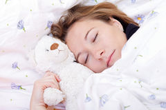 Young woman sleeping Stock Photos