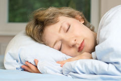 Young woman sleeping. Shallow DOF, focus on eyes Stock Images