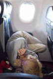 Young woman sleeping on airplane Royalty Free Stock Images