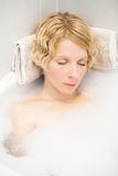Young woman sleeping in the bath Royalty Free Stock Image