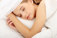 Young woman sleeping on the bed Royalty Free Stock Photography