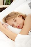 Young woman sleeping on the bed Royalty Free Stock Images