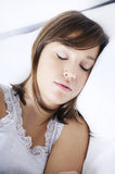 Young woman sleeping on the bed. With white background Stock Photo