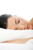Young woman sleeping on the bed Stock Photos