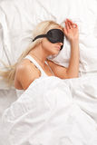 Young woman sleeping on the bed Stock Image