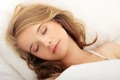 Young woman sleeping on the bed Royalty Free Stock Photo