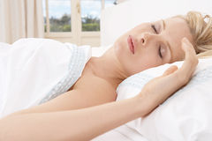 Young woman sleeping in bed. Stock Photography