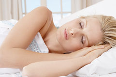 Young woman sleeping in bed. Royalty Free Stock Photo
