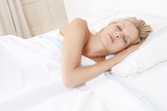Young woman sleeping in bed. Royalty Free Stock Images