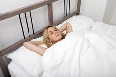 Young woman sleeping in bed Stock Photos