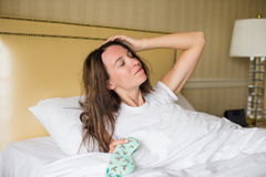 Young woman sleeping in the bed Royalty Free Stock Image