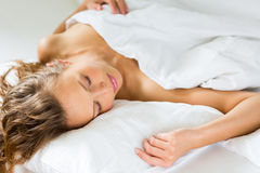 Young woman sleeping in bed Royalty Free Stock Image