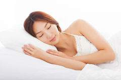 Young  woman sleeping in the bed Royalty Free Stock Photo